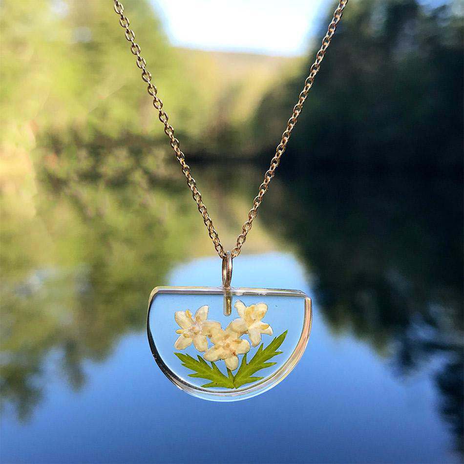 Fair trade botanical resin necklace handmade by artisans in Colombia