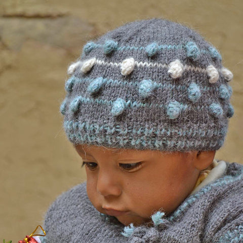 Fair trade baby hat and booties made out of alpaca in Peru