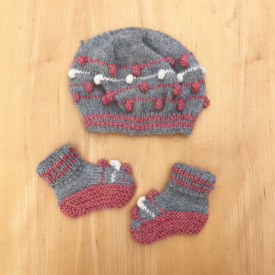 Fair trade baby alpaca hat and booties handmade by women in Peru