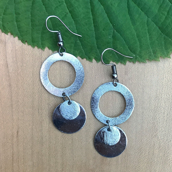 Silver fair trade earrings handmade by marginalized women in India
