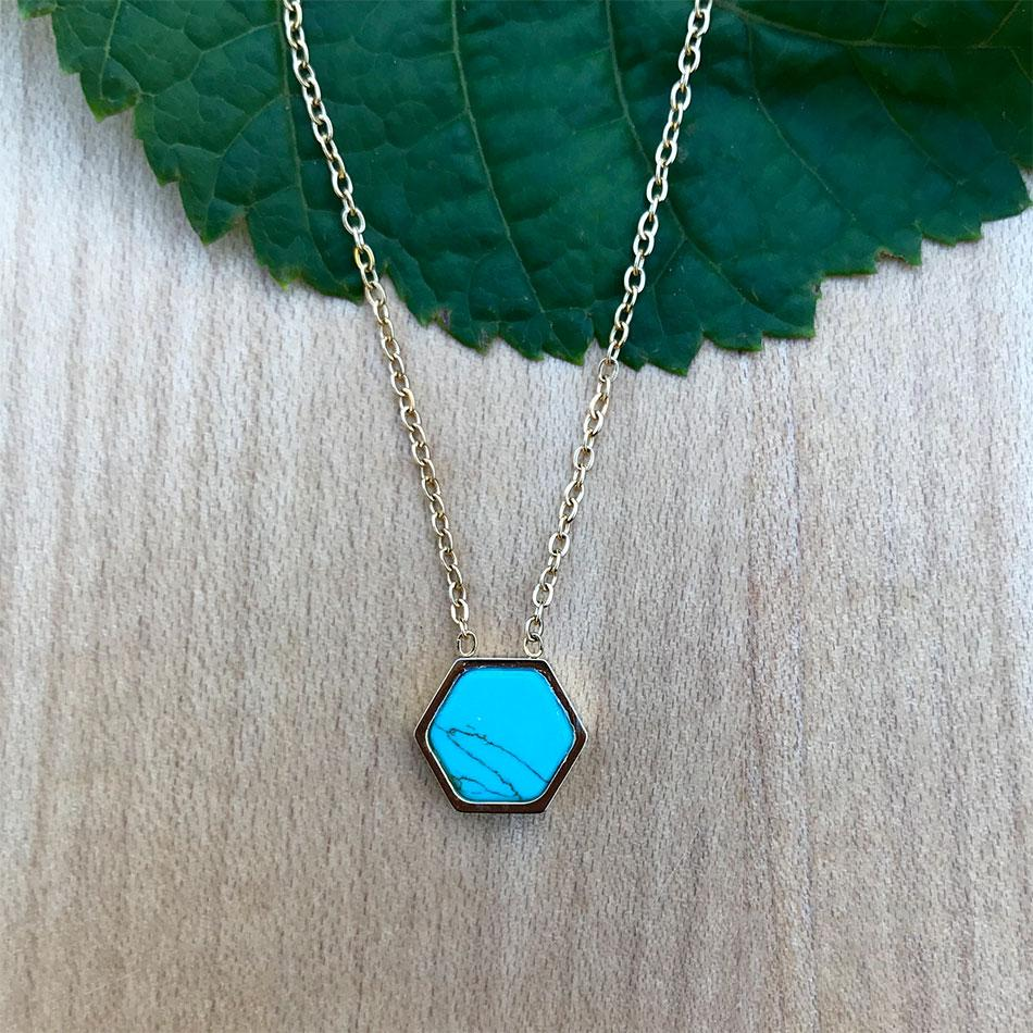 Turquoise necklace handmade by survivors of human trafficking