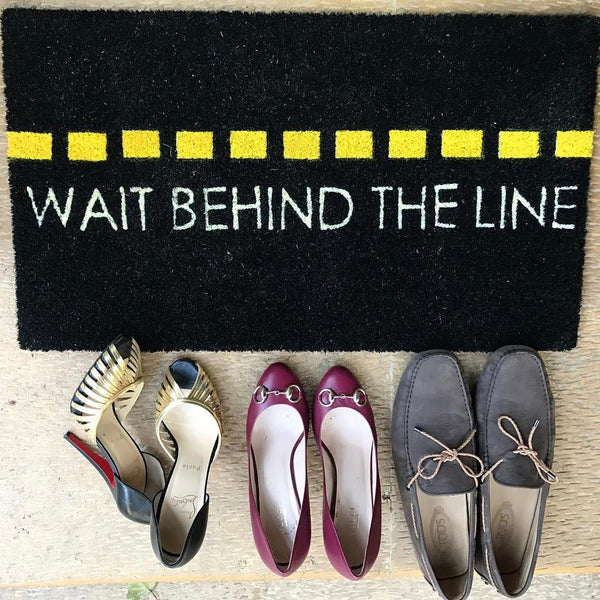 Wait behind the line Door Mat