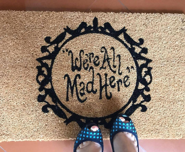 We All Mad Here Door Mat