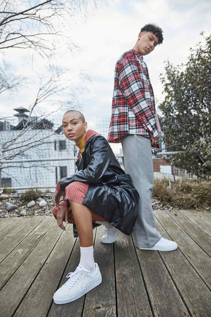 Two Models Wearing LOCI White Sneakers