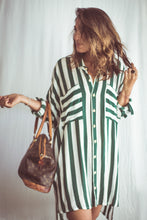 Load image into Gallery viewer, This Green Thick stripe print is both bold and classic. The Tunic has a short cut in the front and a longer back for an interesting siluette. The tunic can be worn with long sleeves, short sleeves, as an open kimono jacket or tied in the waist as an over sized shirt.