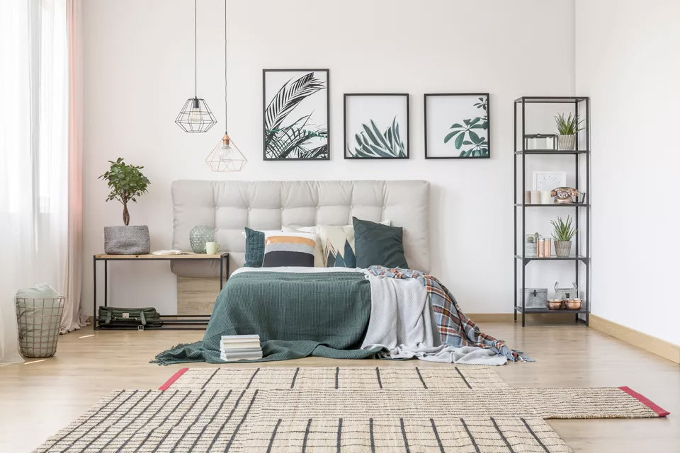 botanical pictures above a green bed