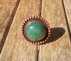 "Stunning Round Jade Stone Surrounded By A Curcular Bronze Ring Setting. ""Such A Statment Ring"