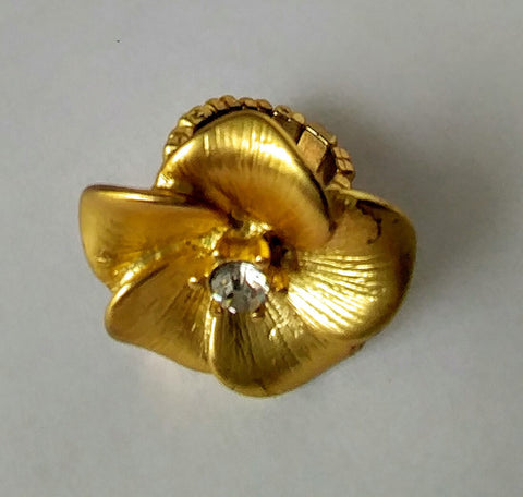"Gold Flower With A Mate Finish Shines With A Faux Diamond Center Makes ""A Simple Classic Statement Peice"""