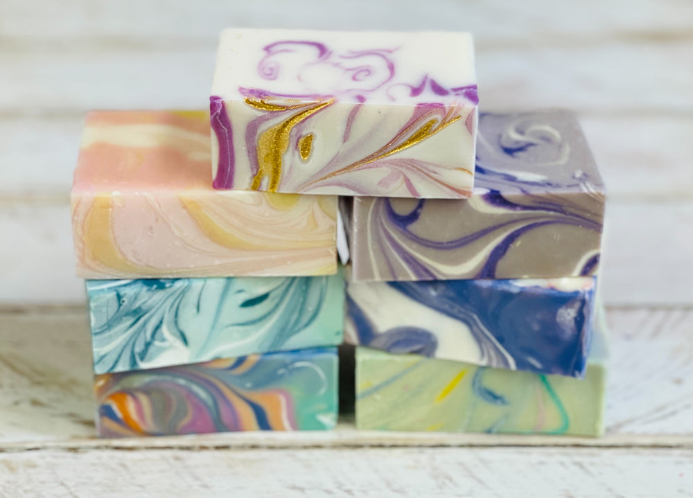 7 bars of soap representing our spring 2021 soap collection. Our spring 2021 collection includes peony and amberwood, fresh pink jasmine, peace and love, hyacinth, willow and Ivy, wild honeysuckle and secret garden.