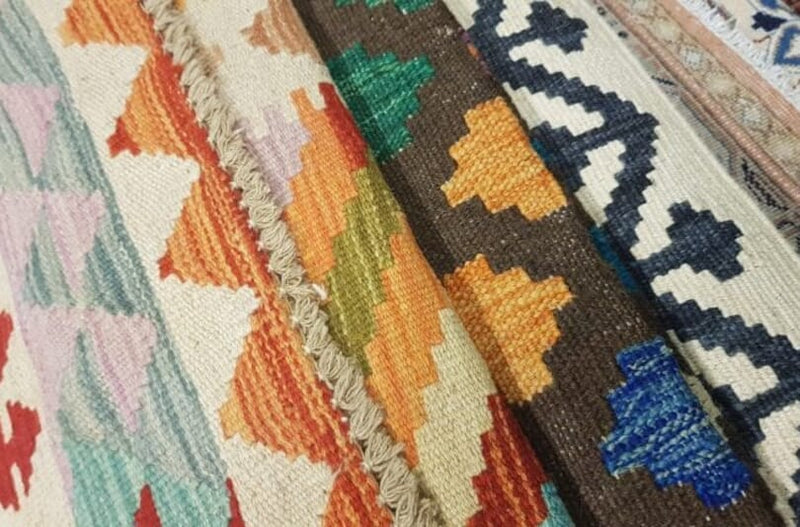 What's the difference between Kilims and Persian Rugs?