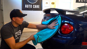 Mitch the detail geek in an auto detail shop with microfiber car drying towel
