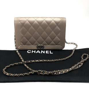 "Primary Photo - BRAND: CHANEL STYLE: HANDBAG DESIGNER COLOR: METALLIC SIZE: SMALL SKU: 262-26211-142826APPROX. 7.5""L X 5.1""H X 1.5""D. STRAP DROP APPROX. 25"". PLEASE NOTE THAT WHILE THIS BAG IS IN GOOD OVERALL CONDITION, THERE IS SOME SLIGHT WEAR REFLECTED IN THE PRICE - SEE PICTURES FOR REFERENCE.CAVIAR QUILTED BOY WALLET ON CHAIN WOC. RESELLING ONLINE FOR $2,600 • RETAIL $2,700"