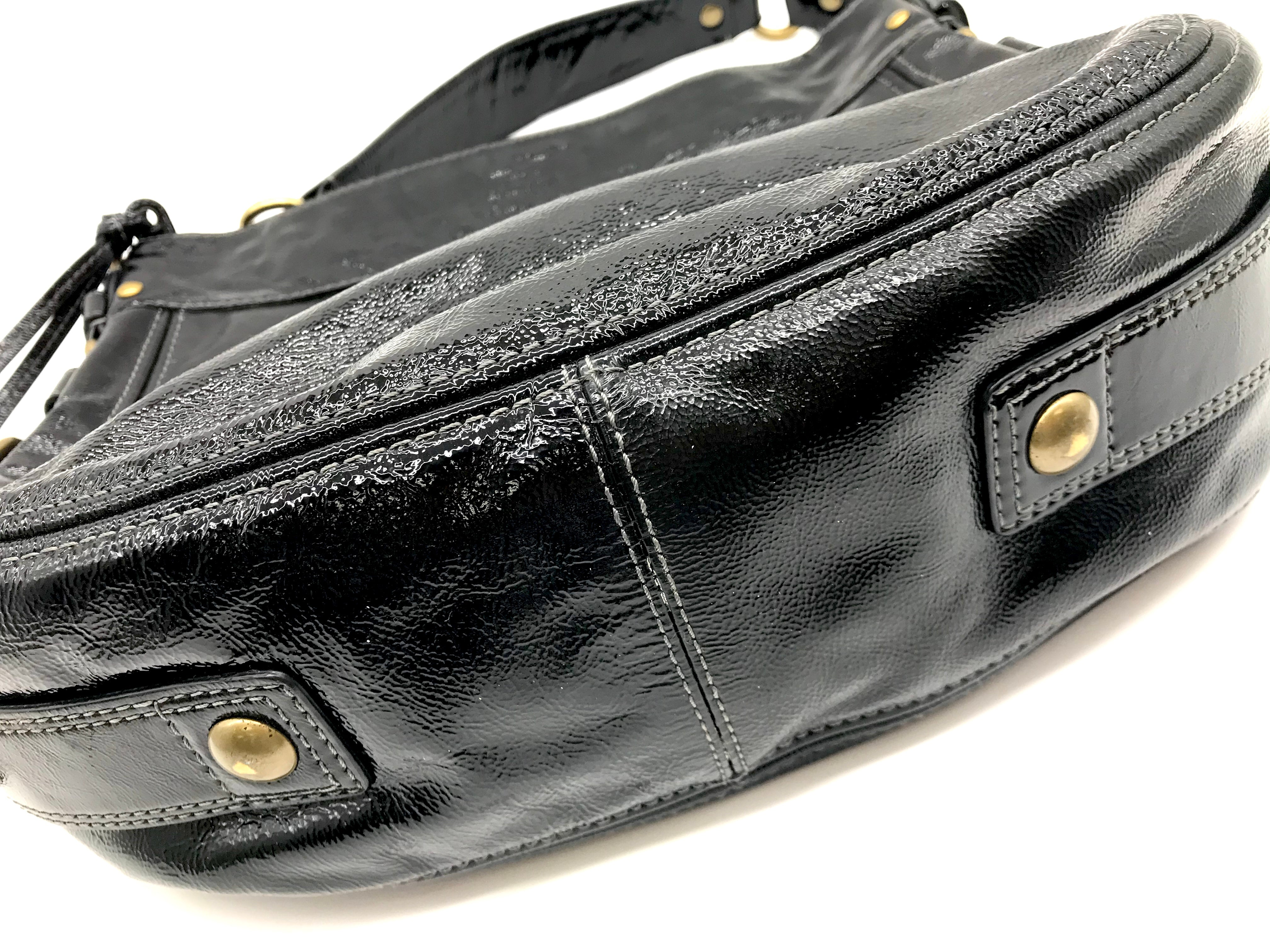 Photo #3 - BRAND: COACH <BR>STYLE: HANDBAG DESIGNER <BR>COLOR: BLACK <BR>SIZE: LARGE <BR>SKU: 262-26275-64721<BR>GENTLE WEAR SHOWS, CRACKS AROUND THE EDGES OF THE STRAP AND SOME STAIN SPOTS ON THE INTERIOR LINING. OVERALL IN GOOD SHAPE AND CONDITION. <BR>DESIGNER BRAND - FINAL SALE