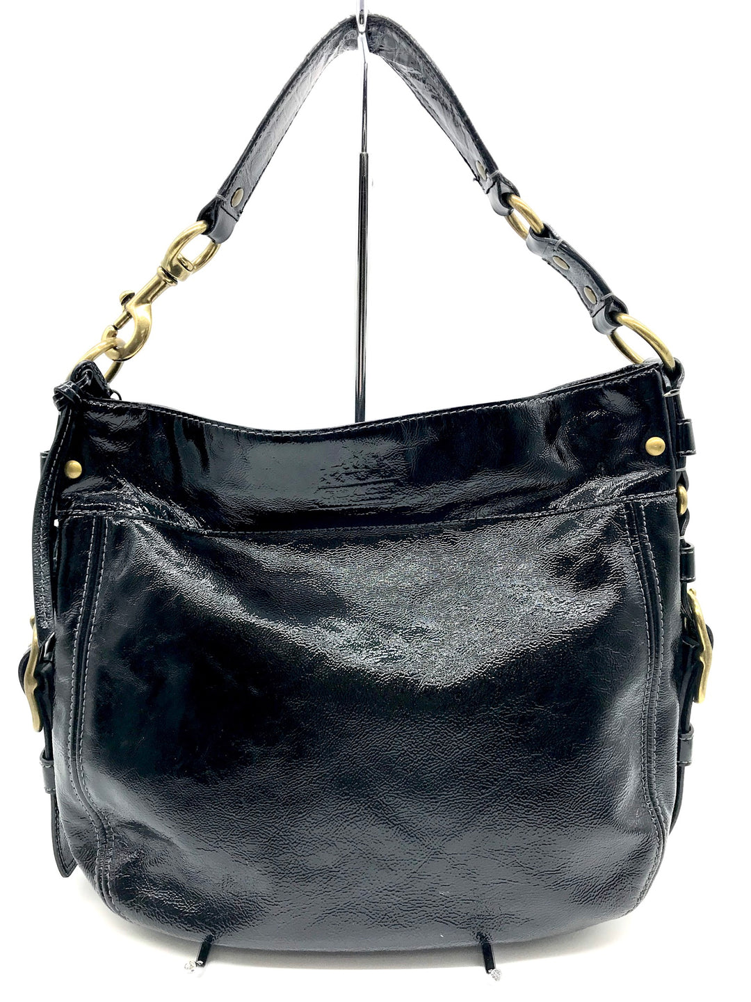 Primary Photo - BRAND: COACH <BR>STYLE: HANDBAG DESIGNER <BR>COLOR: BLACK <BR>SIZE: LARGE <BR>SKU: 262-26275-64721<BR>GENTLE WEAR SHOWS, CRACKS AROUND THE EDGES OF THE STRAP AND SOME STAIN SPOTS ON THE INTERIOR LINING. OVERALL IN GOOD SHAPE AND CONDITION. <BR>DESIGNER BRAND - FINAL SALE