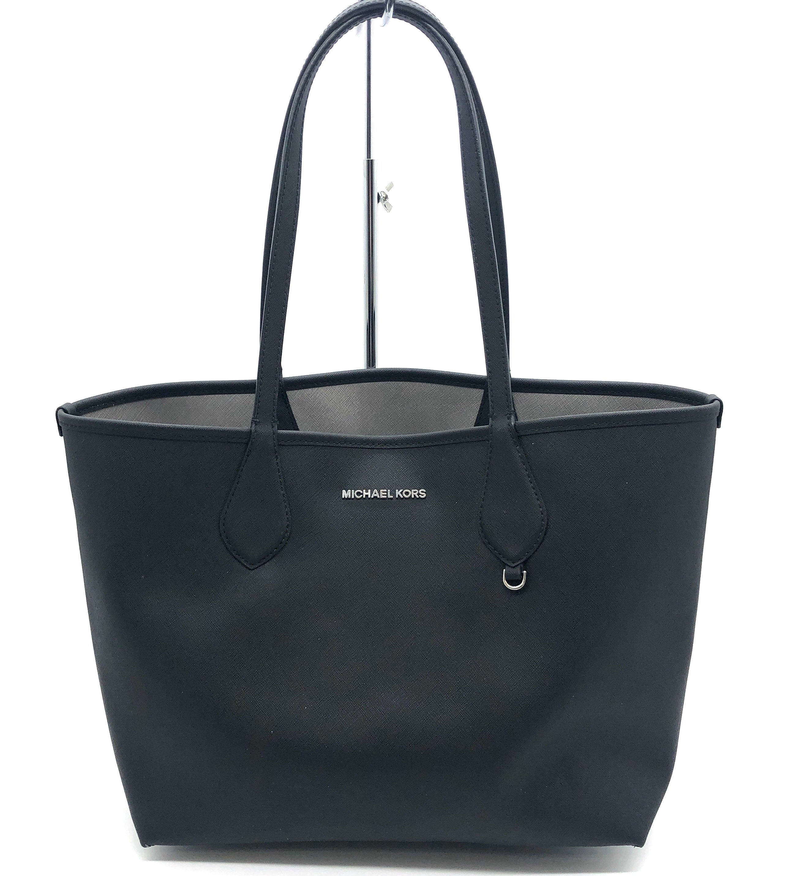 "Primary Photo - BRAND: MICHAEL KORS <BR>STYLE: HANDBAG REVERSIBLE <BR>COLOR: BLACK  GREY <BR>SIZE: MEDIUM <BR>SKU: 262-26275-75789<BR>AS IS WEAR ON CORNERS , SLIGHT MARKS, SPOTS ON GREY SIDE <BR>APPROX 10""X11""X6.5"""