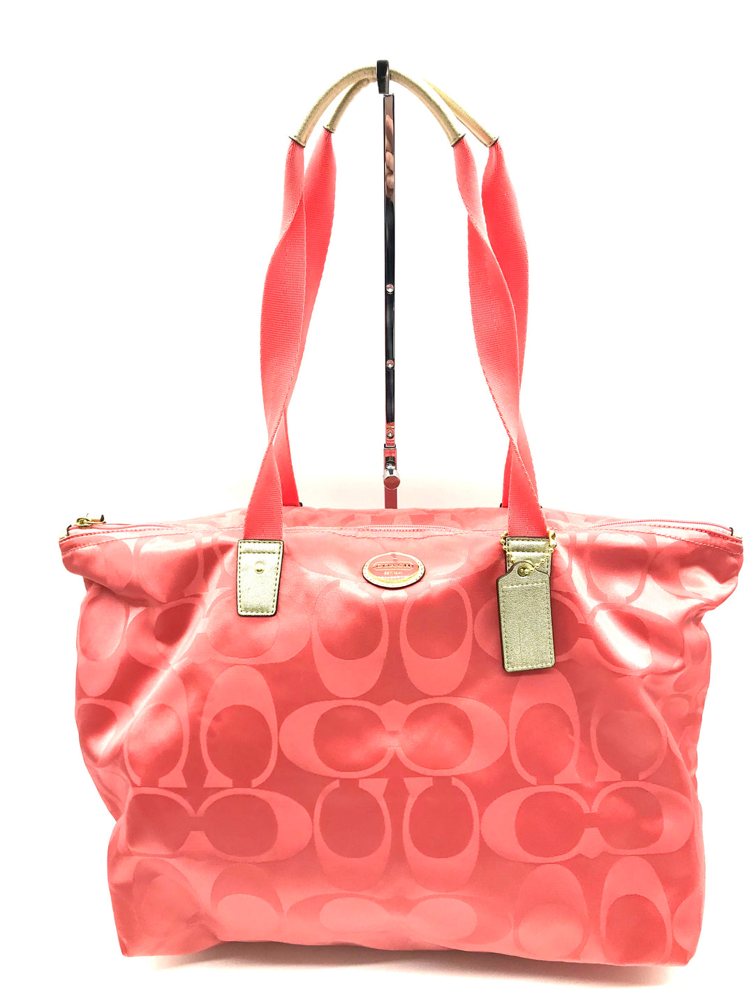 "Primary Photo - BRAND: COACH <BR>STYLE: HANDBAG DESIGNER <BR>COLOR: PEACH <BR>SIZE: LARGE <BR>SKU: 262-26211-131031<BR><BR>APPROX. 17.75""L X 11""H X 7""D. INCLUDES DETACHABLE INTERIOR POUCH APPROX. 10""L X 7.25""H. GENTLE WEAR ON BACK"