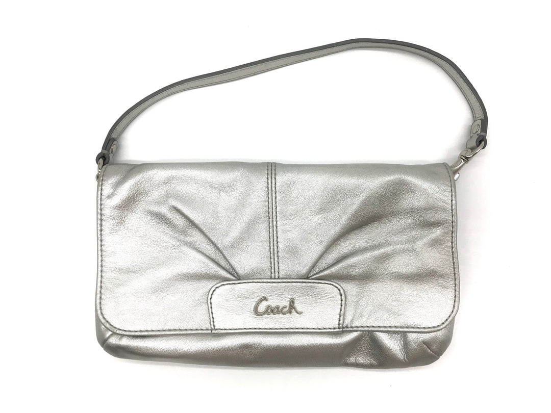 Primary Photo - BRAND: COACH <BR>STYLE: WRISTLET <BR>COLOR: SILVER <BR>SKU: 262-26275-64788<BR>IN GREAT SHAPE AND CONDITION <BR>DESIGNER BRAND - FINAL SALE