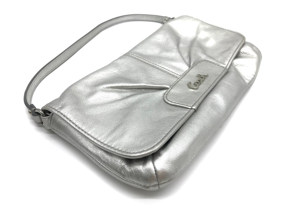 Photo #1 - BRAND: COACH <BR>STYLE: WRISTLET <BR>COLOR: SILVER <BR>SKU: 262-26275-64788<BR>IN GREAT SHAPE AND CONDITION <BR>DESIGNER BRAND - FINAL SALE