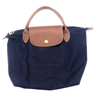 "Primary Photo - BRAND: LONGCHAMP STYLE: HANDBAG DESIGNER COLOR: PURPLE SIZE: SMALL OTHER INFO: AS IS WEAR SKU: 262-26275-74620APPROX. 13""L (TOP) / 7.75""L (BASE) X 8.25""H X 6.25""D.PRICE REFLECTS WEAR INCLUDING GENTLE SPOTS TO OUTSIDE, WEAR/POSSIBLE SMALL HOLES TO CORNERS. FINAL SALE"