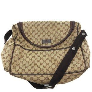 "Primary Photo - BRAND: GUCCI STYLE: DIAPER BAG COLOR: MONOGRAM SIZE: MEDIUM SKU: 262-26275-77165APPROX. 15.5""L X 13""H X 5""D. STRAP DROP APPROX. 16"". PRICE DOES REFLECT SOME VISIBLE WEAR (SLIGHT WEAR TO EDGES, SCUFFING TO SOME OF CANVAS), SOME SHOWN IN PHOTOS, MAY BE MORE SLIGHT WEAR NOT SHOWN.. MISSING CHANGING PAD - ALSO REFLECTED IN PRICE.."