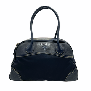 "Handbag Designer By Prada  Size: Medium - BRAND: PRADA STYLE: HANDBAG DESIGNER COLOR: BLACK AND NAVYSIZE: MEDIUM SKU: 262-26241-47981APPROX. 15""L X 10""H X 5""D. PRICE DOES REFLECT SOME WEAR, WHICH CAN BE CLEANED: SOME SLIGHT MARKS TO NYLON, GREY MATERIAL PAINTED INSIDE LOGO - LEATHER AND NYLON CAN BE CLEANED BUT IS PRICED AS-IS, FINAL SALE. SOME SLIGHT MARKS TO CORNERS.INTERIOR AND LEATHER MAY HAVE SLIGHT NAVY TINT COMPARED TO COLOR IN PHOTOS."