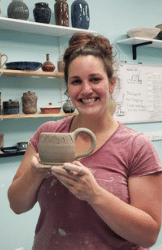 Student happy with first mug!