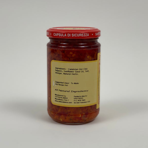 back of tutto calabria hot chili crushed, includes ingredients