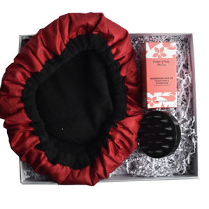 Cordless Microwaveable Deep Conditioning Cap in red colour with a scalp massaging brush in black with a 60 ml nourishing hair oil