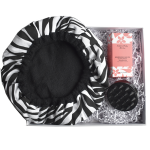 Cordless Microwaveable Deep Conditioning Cap in zebra print colour with a scalp massaging brush in black with a 60 ml nourishing hair oil