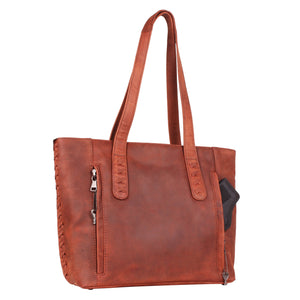 The Concealed Carry Norah Leather Laced Tote is constructed with premium full-grain leather. This superior leather is unique and has its own natural variations in grain and shading. It features intricate leather crisscross stitching on both the front and back with decorative long tassels on the front. CCW Purse in Cognac Rear image with ambidextrous locking concealed carry compartment