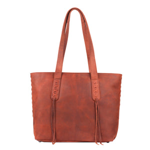 The Concealed Carry Norah Leather Laced Tote is constructed with premium full-grain leather. This superior leather is unique and has its own natural variations in grain and shading. It features intricate leather crisscross stitching on both the front and back with decorative long tassels on the front. CCW Purse in Cognac