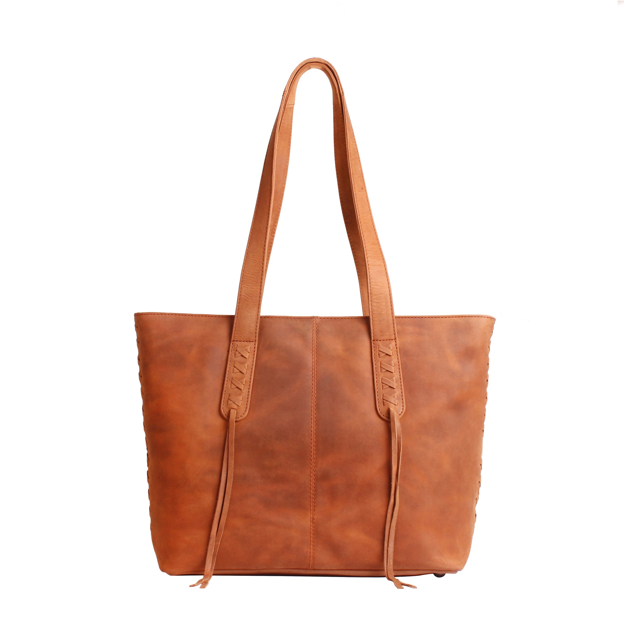 The Concealed Carry Norah Leather Laced Tote is constructed with premium full-grain leather. This superior leather is unique and has its own natural variations in grain and shading. It features intricate leather crisscross stitching on both the front and back with decorative long tassels on the front. CCW Purse in Caramel Front image