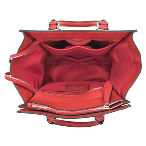 Concealed Carry Aphaea Satchel Handbag. Bright Red Exterior and interior. Cut Proof Wire reinforced straps and handles. One big open interior with 2 open pockets on one side and a zipper compartment on the other intieror wall. Zipper on top. Silver toned Hardware to top off the sleek look. Concealed Carry Compartment is in rear of the satchel. Opens on both left or right side for left and right handed users.
