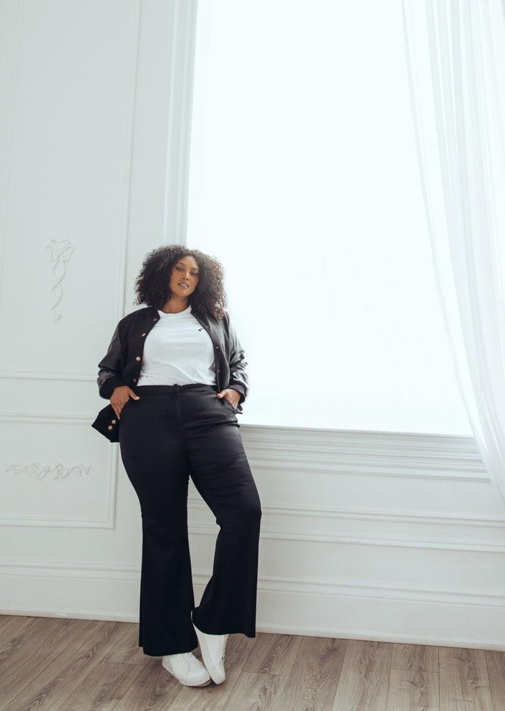 Model wearing plus size flare pants.