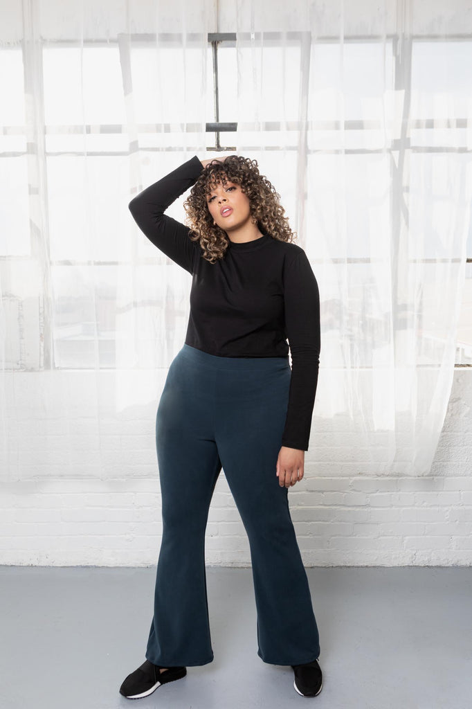 Blue flare pants on plus size model.