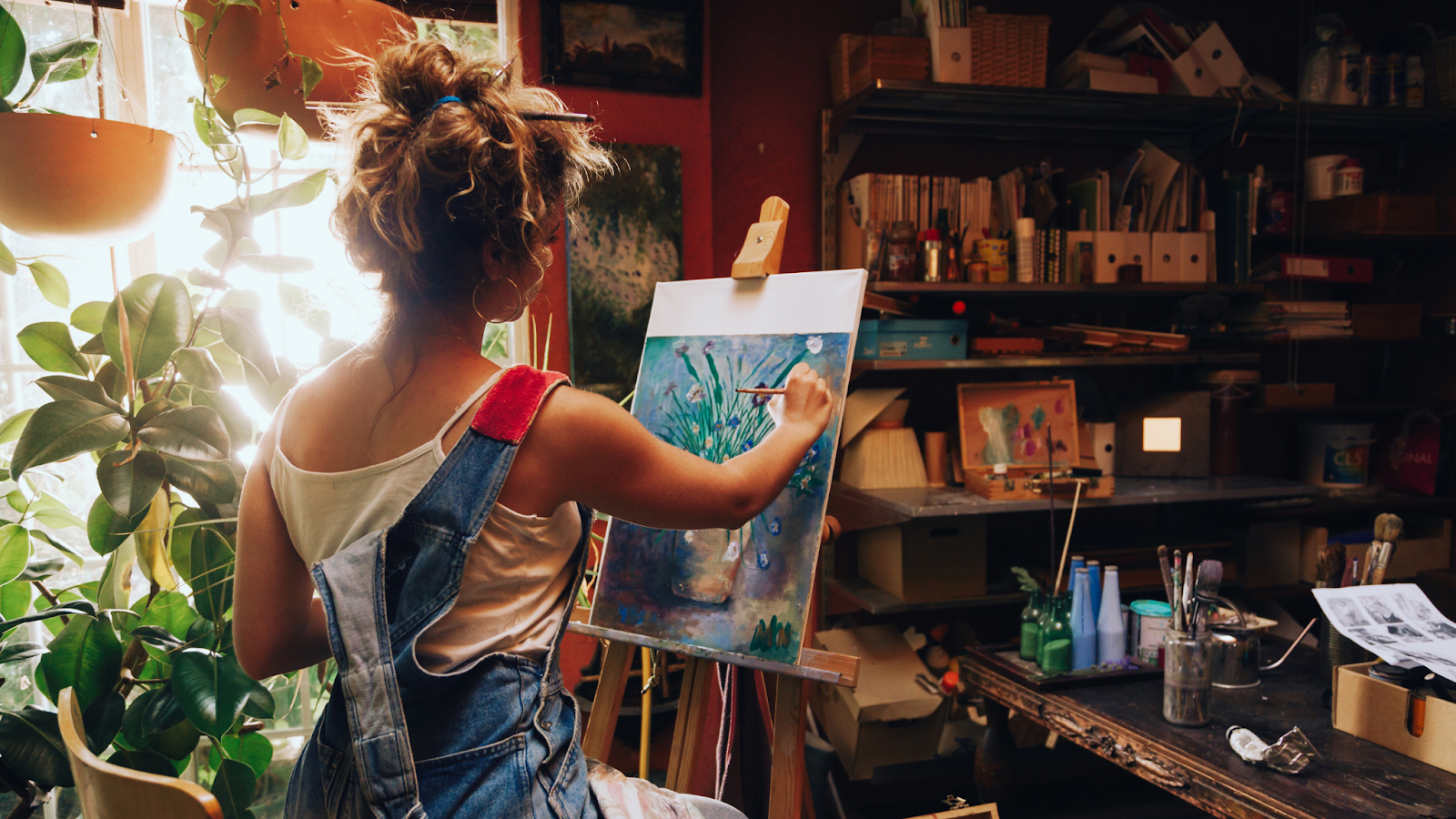 A woman painting in her studio