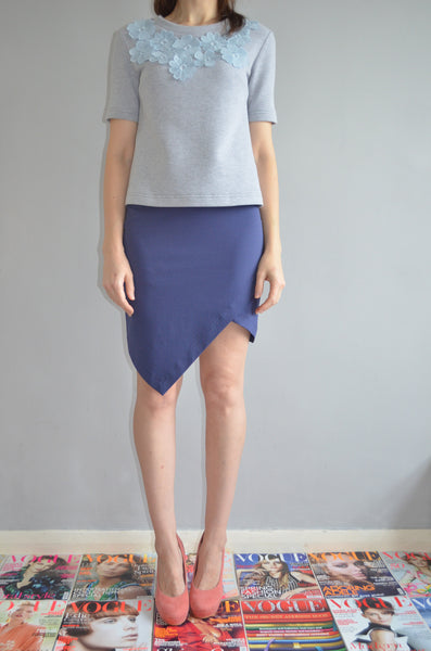 Mini skirt with asymmetric front detail