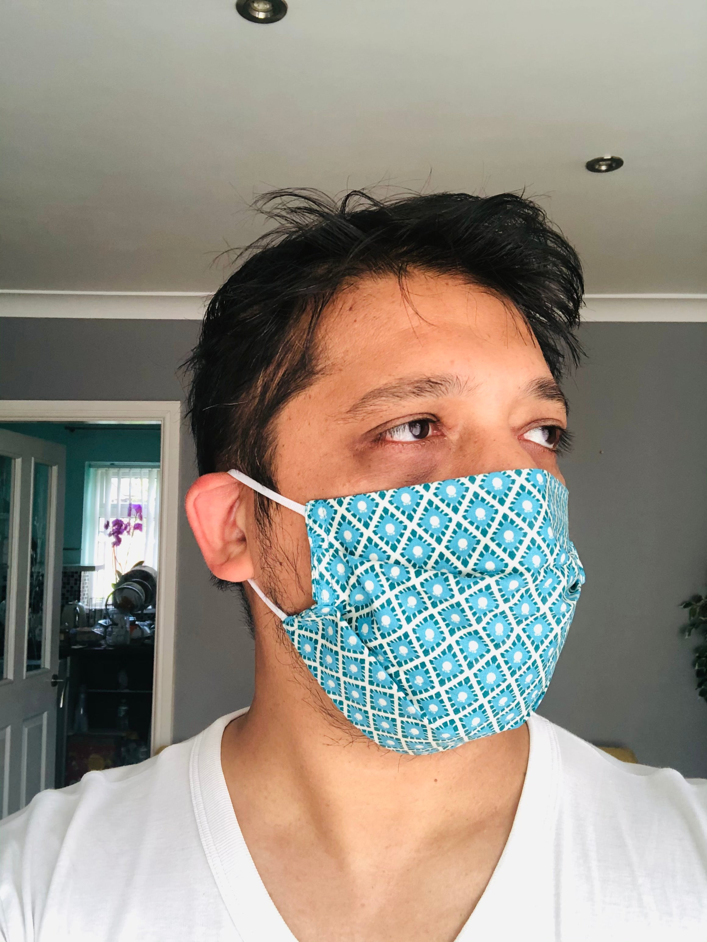 Person Wearing Premium Pleated Cotton Face Mask