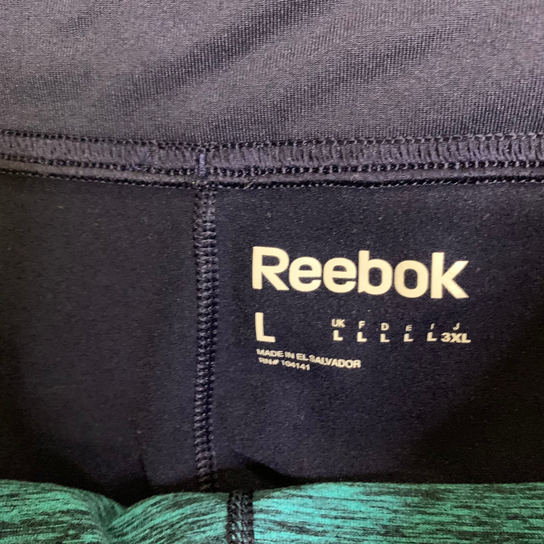 Athletic Capris By Reebok  Size: L - BRAND: REEBOK <BR>STYLE: ATHLETIC CAPRIS <BR>COLOR: BLUE <BR>SIZE: L <BR>OTHER INFO: NAVY/TEAL <BR>SKU: 257-257183-2142