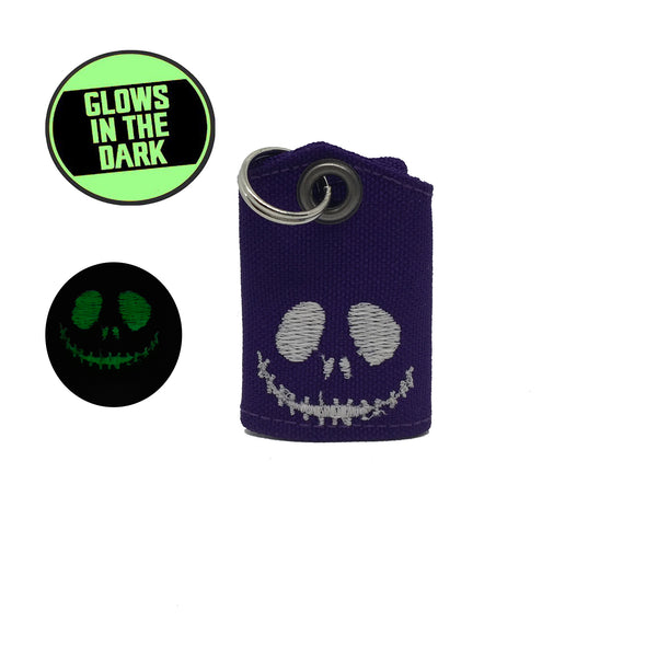 "Skeleton Smile Glow-in-the-dark ""Tag Bag"" medal protector and silencer"