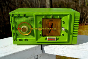 SOLD! - Jan 30, 2018 - CHARTREUSE Mid Century Retro Jetsons 1954 Firestone 4-A-134 Tube AM Clock Radio Extremely Rare! - [product_type} - Firestone - Retro Radio Farm