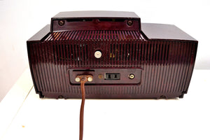 SOLD! - Mar 3, 2020 - Burgundy Brown 1957 General Electric Model 912 Vacuum Tube AM Clock Radio Solid Player Lovely Swirl! - [product_type} - General Electric - Retro Radio Farm