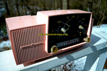 Load image into Gallery viewer, SOLD! - Mar 5, 2018 - ROSE PINK Mid Century Jetsons 1959 General Electric Model 915 Tube AM Clock Radio Near Mint!