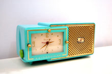Load image into Gallery viewer, Faberge Turquoise and Gold 1957 Bulova Model 100 AM Clock Radio Simply Fabulous! - [product_type} - Bulova - Retro Radio Farm