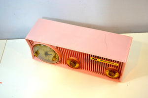 SOLD! - Jan 26, 2020 - Pink Velvet 1957 Motorola 57CS Port Hole Tube AM Clock Radio Totally Restored! - [product_type} - Motorola - Retro Radio Farm