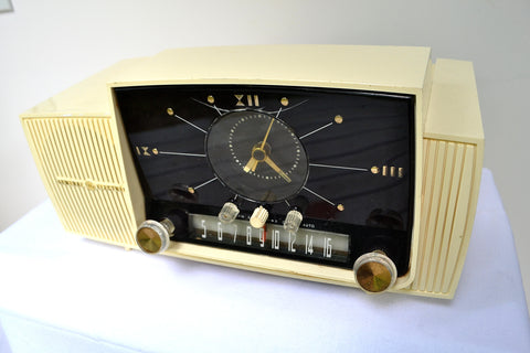 SOLD! - Aug 8, 2018 - CREAM IVORY Mid Century Jetsons 1957 General Electric Model 912 Tube AM Clock Radio Sweet!