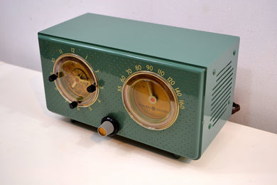 SOLD! -Nov 22, 2019 - Mariner Green 1954 General Electric Model 566 Retro AM Clock Radio Porthole Design Sounds Great!