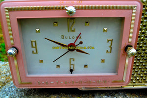 SOLD! - May 4, 2017 - FIFTH AVENUE PINK Mid Century Retro Jetsons 1957 Bulova Model 120 Tube AM Clock Radio Excellent Condition!