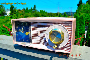 SOLD! - Aug 2, 2014 - MID-CENTURY MARVEL Pink Retro Jetsons Late 50's early 60's Motorola C23P Tube AM Clock Radio WORKS! - [product_type} - Motorola - Retro Radio Farm