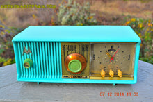 Load image into Gallery viewer, SOLD! - Dec 17, 2014 - VIVID Turquoise Retro Jetsons 1957 Motorola 57CC Tube AM Clock Radio WORKS! - [product_type} - Motorola - Retro Radio Farm